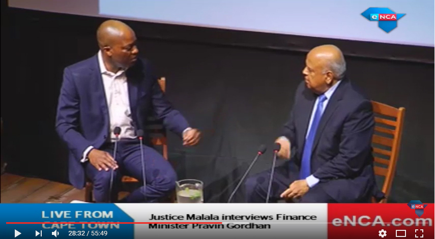 Screen shot of the eNCA video of Justice Malala interviewing South African Finance Minister Pravin Gordhan, as part of the Cape Town Open Book Festival