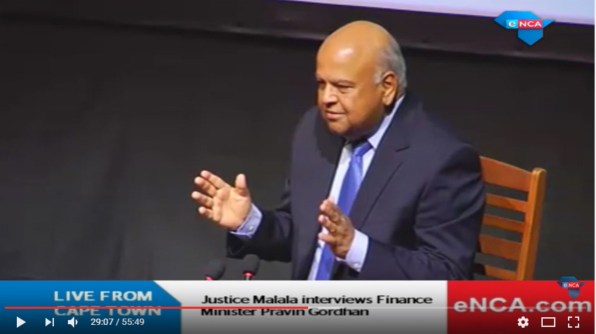 Screen shot of the eNCA video of South African Finance Minister Pravin Gordhan interviewed by Justice Malala, as part of the Cape Town Open Book Festival