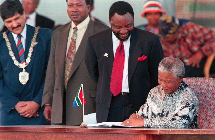 Signing the SA Constitution: Cyril Ramaphosa and Nelson Mandela
